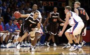 Kansas' Keith Langford pressures Pacific's Marko Mihailovic (1). Langford led the Jayhawks with 21 points.