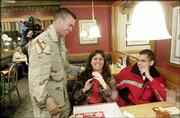 Darrell Hunsaker, who has been serving in Iraq with the Army, surprises his mother Robin Hunsaker at Perkins Restaurant on a two-week leave from service in Iraq. At right is Darrell's stepbrother Jeremy Williams.