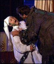 "JACOB MARLEY, RIGHT, played by actor Jeff Conaway, of ""Grease"" and ""Taxi,"" holds Ebenezer Scrooge, played by Greg Younger, during a rehearsal of Charles Dickens&squot; ""A Christmas Carol"" in Albany, N.Y. The traveling production is among a number of duplicates of the popular Christmas story available this season."