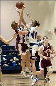 Baldwin High's Denise Orloff blocks the shot of Eudora's Kayla Moyer (44).