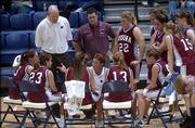 Eudora High girls basketball coach Cara Kimberlin, center, talks to her team during a timeout at the third-place game of the Eudora Invitational against Baldwin. The Bulldogs beat the Cardinals, 44-34, Thursday at Eudora High.