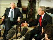 President Bush, right, along with Treasury Secretary John Snow, left, meets with the Social Security Trustees in the Oval Office of the White House. Bush on Thursday flatly ruled out raising payroll taxes to ensure the solvency of Social Security, as he opened a push for historic changes in the retirement program.