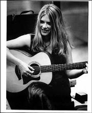"""Ashley Davis will release her Celtic-themed CD, """"Closer To You,"""" today in Lawrence."""