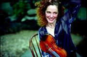 """Three-time U.S. Scottish fiddle champion Bonnie Rideout and a troupe of Celtic musicians performed """"A Scottish Christmas"""" Friday evening at the Lied Center."""