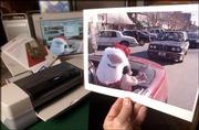 An 8-by-10 enlargement of Santa Claus was made from a digital file using Adobe Photoshop CS software and a digital photo quality printer. The Journal-World photo department uses an Epson 1280 printer that accepts ink cartridges and paper up to 11-by-17 inches.