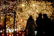 "Trees decorated for the season glow with thousands of lights as holiday shoppers walk along the legendary ""Magnificent Mile"" -- North Michigan Avenue in Chicago. Big-name retailers line the city&squot;s premier shopping strip."
