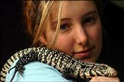 Ginny Weatherman, 21, says she is fascinated with reptiles. The Kansas University junior has six snakes and two lizards, one of which rests on her shoulder. The lizard's named is Artemis, a tegu from Argentina.