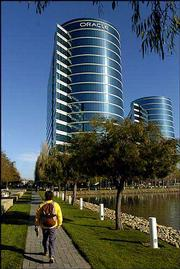 Redwood Shores, Calif.-based Oracle Corp. raised its takeover bid for bitter rival PeopleSoft Inc. by 10 percent to seal a $10.3 billion deal that will create the world's second-largest maker of business applications software. The agreement, announced Monday, caps a Silicon Valley feud that has been marked by surly exchanges between the companies' management teams and courtroom battles.