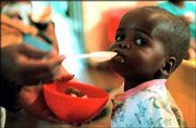 An unidentified baby is fed at a home for HIV/AIDS on World Aids Day in this file photo in Soweto, South Africa, Dec. 1, 1998. The United States sent doses of nevirapine to Africa to treat pregnant mothers with HIV.