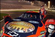 Jeff Gordon's car bears a hood emblem dedicated to the Hendrick team members who died in a plane crash in late October.