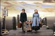 "Liam Aiken, left, Kara Hoffman and Emily Browning star as resourceful orphans in ""Lemony Snicket&squot;s."""