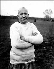 Notre Dame football coach Knute Rockne is shown in 1925 at an unknown location. The goals are as lofty as they were in Rockne's day, but the Fighting Irish football program has been in a 10-year decline.