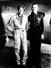 Famed aviator Amelia Earhart and her navigator, Fred Noonan, pose in front of their twin-engine Lockheed Electra in Los Angeles in May 1937, before their attempt to fly around the world. Marine explorer David Jourdan plans to launch an expedition in spring 2005 to sweep the ocean floor in a 1,000-square-mile swath of water with sonar to find Earhart's missing plane.