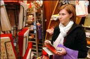 Chicago resident Jennifer Bell shops at Hobbs, 700 Mass. She is among the last-minute holiday shoppers that stores are hoping to see, especially today. With Christmas Eve falling on a Friday, the day is expected to be busier than usual.