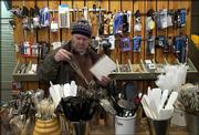Dave Hamill, Lawrence, inspects a metal whisk while holding his gift list at the Bay Leaf, 725 Mass. Hamill, who shopped for his wife on Friday in downtown Lawrence, was one of many residents who did some last-minute holiday shopping.