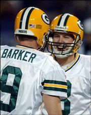 Green Bay kicker Ryan Longwell, right, celebrates with holder Bryan Barker after making a game-winning 29-yard field goal. Longwell's kick as time expired gave the Packers a 34-31 victory over Minnesota on Friday in Minneapolis.