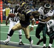 St. Louis' Steven Jackson (39) beats Philadelphia's Michael Lewis to the end zone for a first-half touchdown in the Rams' 20-7 victory. The Rams won Monday in St. Louis.