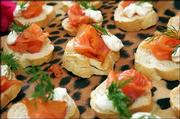 "Smoked Salmon on Toasted Rye rounds with dilled cream cheese and sour cream is a creation of Alice&squot;s Key West chef-owner Alice Weingarten. She suggests serving the canapes with champagne for a party following a theme of ""Bubbles and Bites."""