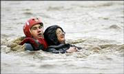 Flooding rains continue to deluge parts of California. Department of Forestry firefighter Alec Flatos rescued a woman Thursday from the flooded San Luis Creek in San Luis Obispo, Calif. In Southern California, two days of downpours have brought up to 12 inches of rain and scores of road accidents.