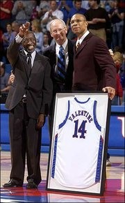 Former Kansas assistant coach Lafayette Norwood, left, and former head coach Ted Owens, center, join Darnell Valentine for his jersey-retirement ceremony at halftime of the KU-Georgia Tech game on Jan. 2, 2005, at Allen Fieldhouse.
