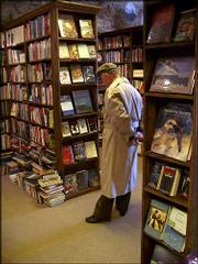 This candid snapshot of my father, browsing the aisles of a bookstore and captured on a pocket-sized digital camera, made me realize again the joys of making photographs, both as a lifelong hobby and an occupation.
