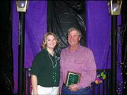 Douglas County 4-H'er Cybill Milburn presents the 2004 Outstanding 4-H Alumni Award to Richard Ice. He received the award Nov. 2 at the Douglas County 4-H Achievement Celebration at the Douglas County 4-H Fairgrounds.