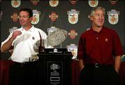 Oklahoma coach Bob Stoops, left, poses next to the Bowl Championship Series trophy with Southern California coach Pete Carroll. The two coaches attended a news conference Monday in Ft. Lauderdale, Fla., to discuss the Orange Bowl, which will serve as the BCS Championship game, between the Sooners and Trojans tonight in Miami.