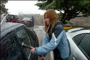 """Elyse Schminke, a Kansas University junior, got to leave her student job on campus early Tuesday as rain began to fall and cars, sidewalks and trees became coated with ice. KU dismissed workers at 3 p.m. so they could get home safely.<br> <a href= """"http://etc.lawrence.com/galleries/icestorm/6850_lores.html"""" target=""""_new"""" onclick= """"window.open(&squot;http://etc.lawrence.com/galleries/icestorm/6850_lores.html&squot;,&squot;Photo&squot;,&squot;height=650,width=550,screenX=10,screenY=10,&squot; + &squot;scrollbars,resizable&squot;); return false;""""> <img src=""""http://www.ljworld.com/art/icons/icon_photo.gif"""" border= """"0"""" alt=""""photo"""">Photo Gallery: Winter storm</a><br>"""