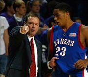 Kansas University men's basketball coach Bill Self, left, chats with KU forward Wayne Simien in a game from the 2003-04 season. Self's 2004-05 Jayhawks are 9-0 and tonight will face his old assistant, Billy Gillispie, and his 11-0 Texas A&M Aggies.
