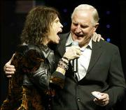 Steven Tyler, left, of Aerosmith, sings with Craig Barrett, CEO of Intel, as Barrett delivers the keynote address of the Consumer Electronics Show in Las Vegas.