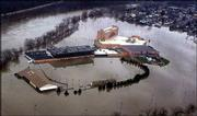The Wheeling Island Racetrack and Gaming Center is engulfed by water from the Ohio River in Wheeling, W.Va. Flooding along the Ohio damaged hundreds of homes and businesses in Ohio and West Virginia, and water is not expected to recede until this afternoon.