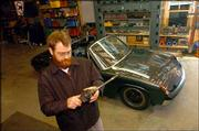 Chris Cunningham tinkers around his garage, especially spending time on his 1972 Porsche 914. Cunningham and his wife, Amy, built the 764-square-foot detached garage themselves -- with a bit of help. The garage has a television, sink, phone line, stereo and soda machine.