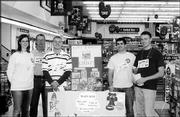 From left are Brianna Kelly, Tom Patchen, Jason Moulin, Torey Gerwin and Bob Podany. They helped raise funds for the Boys and Girls Club of Lawrence at Dillons, 1740 Mass. Roundup Day, when club representatives ask Dillons customers if they would like to round up the total of their purchases to benefit the nonprofit organization, was Oct. 30. Patchen is president of the club's board of directors.