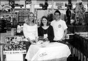 Kansas University students, from left, Jessica Vega, Erin Hogan and Nick Wright help raise funds for the Boys and Girls Club of Lawrence at Dillons, 1015 W. 23rd St. The students are members of Beta Alpha Psi, an honorary accounting fraternity. They worked Oct. 30 on Roundup Day, when club representatives ask Dillons customers if they would like to round up the total of their purchases to benefit the nonprofit organization.