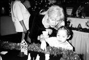 Barbara Hillmer looks at a nativity scene with Xiannah Washburn. They attended a Mother to Mother Tea on Dec. 5 at Centenary United Methodist Church.