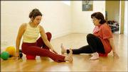 "Traci Sampson demonstrates body rolling techniques to Beatrice Blatteis at Midtown Yoga in New York. This technique, developed by yoga guru Yamuna Zake, involves using balls of various sizes and firmness to massage deep muscles and to ""open space"" between the muscles, joints and bones."