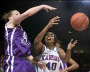 Kansas University forward Crystal Kemp (40) fights for a loose ball with Kansas State's Kendra Wecker during the second half. Kemp was held to 10 points, and the Wildcats beat the Jayhawks, 63-45, Saturday at Allen Fieldhouse.