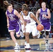 KU's Erica Hallman, center, pushes the ball as Kansas State defenders Laurie Koehn, left, and Kendra Wecker trail.