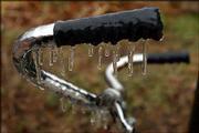 Icicles hang from the handlebars of a bicycle locked at Kansas University.