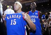 Kansas University's J.R. Giddens (15) and Moulaye Niang run into the tunnel as they celebrate the Jayhawks' victory over Kentucky in front of Rupp Arena fans. The Jayhawks won, 65-59, at the venerable venue Sunday in Lexington, Ky.