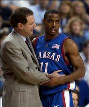 Kansas University men's basketball coach Bill Self, left, chats with KU senior guard Aaron Miles during their game against Kentucky. The Jayhawks won, 65-59, Sunday in Lexington, Ky.