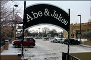 The owner of Abe & Jake's Landing, Mike Elwell, wants to renegotiate his parking contract with the city of Lawrence. Elwell now pays $4,800 a year so that patrons may park for free in the city-owned garage and parking deck outside the bar at Sixth and New Hampshire streets.