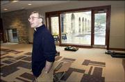 Victor Bailey, director of the Hall Center for the Humanities, tours the center's new building on the Kansas University campus. The building opened Monday in the renovated shell of the 1887 powerhouse, formerly the oldest building on the KU campus.