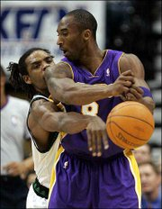 Minnesota guard Latrell Sprewell, left, reaches in to knock the ball away from Los Angeles guard Kobe Bryant. The Lakers rallied for a 105-96 victory in the fourth quarter without Bryant, who did score 31 points Monday in Minneapolis.