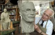 Sculptor Elden Tefft finishes a bust of James Naismith in his Lawrence studio. Tefft and Merlyn Brown, both of Lawrence, hope to create a park dedicated to the memory of James Naismith and the history of basketball. The park would include a full-size basketball court pavilion with benches around the court and life-sized sculptures of people significant to the history of basketball.