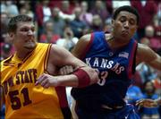 Kansas University All-America candidate Wayne Simien, right, battles for a rebound with Iowa State's Jared Homan late in the Jayhawks' 71-66 victory. In his first game back after having surgery on his left thumb, Simien collected 13 points and nine rebounds as the Jayhawks held off the Cyclones on Wednesday at Hilton Coliseum in Ames, Iowa.