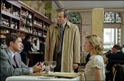 "Dan Foreman (Dennis Quaid), standing, discovers his boss, Carter Duryea (Topher Grace), lunching with his daughter, Alex (Scarlett Johansson), in ""In Good Company,"" a comedy from writer/director Paul Weitz."
