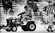 "Mark Henderson, a convicted burglar on work release from the Massachusetts Correctional Institution in Norfolk, Mass., clears snow in this file photo from Dec. 12, 1982, at Schaefer Stadium in Foxboro, Mass. Henderson was involved in a controversial play in the fourth quarter when he plowed an area where the Patriots&squot; John Smith kicked the winning field goal in the ""Snow Plow Game."""