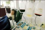 Bad weather is blamed for the blood shortage at the Community Blood Center, 1410 Kasold Drive. Janice Richardson, of Lawrence, was in the center Monday afternoon donating platelets used for cancer patients.