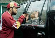 "Former rapper Ice Cube, left, scolds Philip Daniel Bolden in the family road comedy, ""Are We There Yet?"""